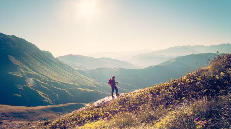 Hiker Climbing a Hill
