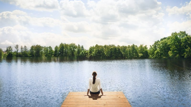 Woman on Dock Looking at Water_